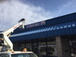 Old sign coming down.
